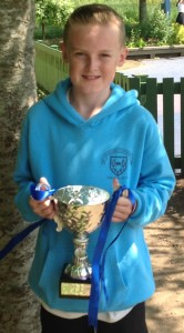 Fairley won the inter-house basketball cup and Jason Anderson captain of Fairly collected the cup